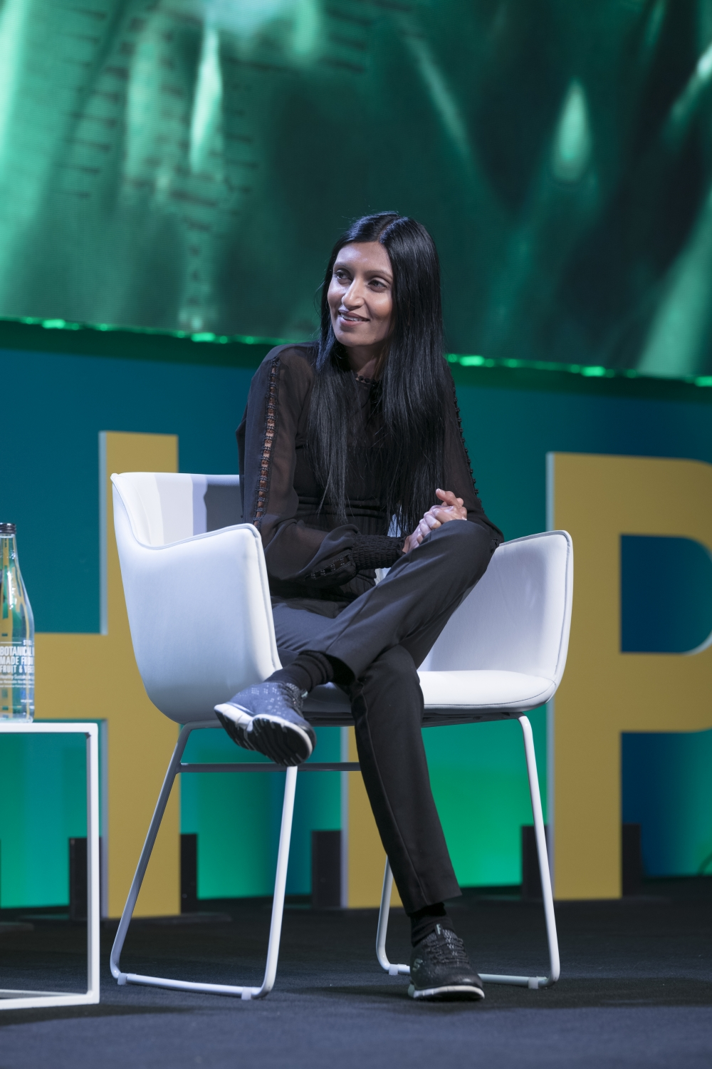Closeup of Shama Sukul Lee taking part in a panel discussion at Global Table 2019